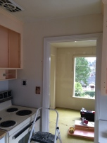 Kitchen with wallpaper off.